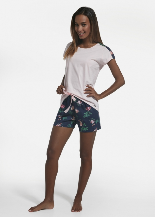 Women's pajama set consisting of a pink T shirt with a printed strip on the sleeves and navy blue shorts covered with floral prints.