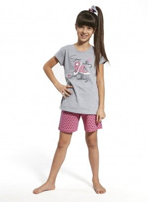 Girl's pajama set consisting of a printed T. Shirt and shorts covered with heart patterns.