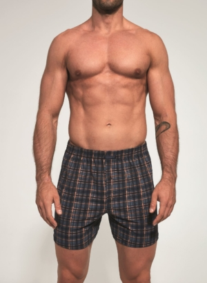 Men's boxer shorts are soft to the touch and display a casual and comfortable design with a print of black, gray and orange plaid pattern.